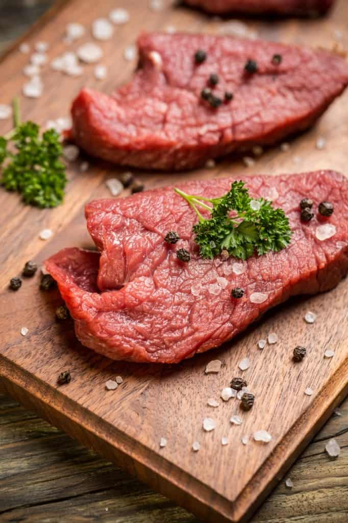 beef slices on chopping board